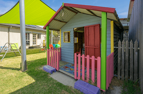 Outdoors at Keysborough Freedom Club Childcare Center Cubby House